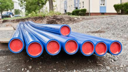 A small pile of PVC tubing lays, ready to be put in the ground for water use